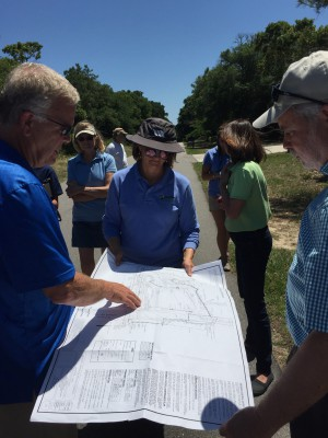 Civil engineer Brad Sedgwick, left, explains a stormwater system to Tracy Skrabal and Todd Miller of the North Carolina Coastal Federation during the tour of Oak Island. Photo: Ashita Gona