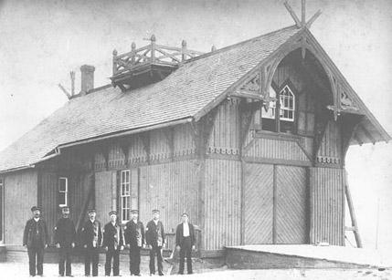 The Kitty Hawk Lifesaving Station and its crew around 1900. Photo: Library of Congress image enhanced by Joyner Library, East Carolina University.
