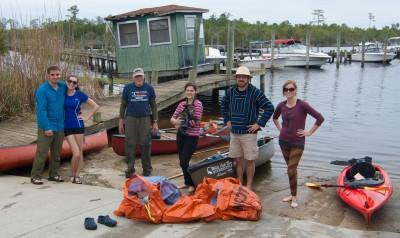 Volunteers pick up trash along Chaney Creek in Jacksonville. Photo; White Oak-New Riverkeeper Alliance