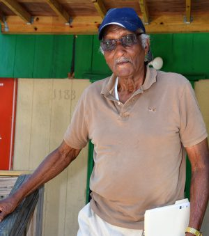 """Louis """"Bobby"""" Brown, 85, of Navassa, heads out the door at the Countywide Community Development Corp. office in town on his way to a meeting Friday. He worked at the Kerr-McGee site for about three years as a young man. Photo: Mark Hibbs"""