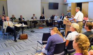 Mike Lopazanski of the Division of Coastal Management talk to the CRC about the sandbag rules. Photo: Mark Hibbs