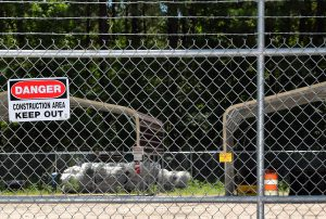 Signs at the former Kerr-McGee Chemical Corp. site warn people to keep out. The site has been unused since creosote operations ceased in the 1970s. Photo: Mark Hibbs