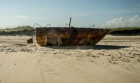 The Coast Guard interdicted the rusted boat off South Florida. The passengers were removed and the boat set adrift. It washed ashore at Cape Lookout National Seashore. Photo: Joanie Alexander
