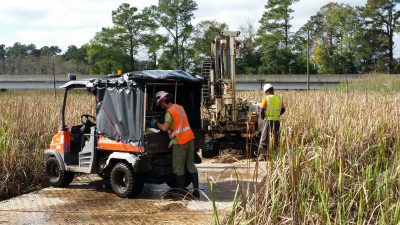 Multistate trust contractors use swamp mats to move equipment into place to take soil samples in the marsh. Photo: Greenfield Environmental Multistate Trust