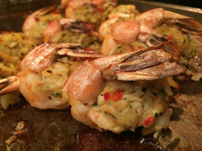 Bake the stuffed shrimp uncovered in the preheated oven at 375 degrees for about 15 minutes, until the shrimp are pink and the crab meat is heated through. Alternately, cook the stuffed shrimp on a fine-mesh or foil-lined grate on a hot, covered grill. Photo: Liz Biro