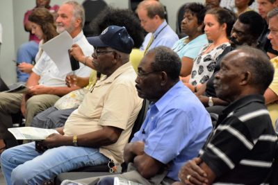 Townspeople listen as officials explain the what will happen over the next year. Photo: Mark Hibbs