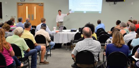 About 65 people attended a meeting Tuesday night to learn about the latest plans to clean up a Superfund site in Navassa. Photo: Mark Hibbs