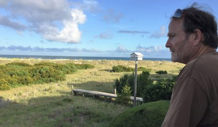 David Morrisette looks at the unspoiled land stretching from his family beach home on Figure Eight Island to the Atlantic Ocean. The terminal groin proposed to be built across the island's northern end would be built through a portion of the family's property. Morrisette said he and his siblings, whom own the home, will not willingly grant the private island's homeowner's association's board of directors an easement to their property. Photo: Trista Talton