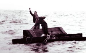 Survivors of a torpedoed merchant ship cling to the wreckage off the North Carolina coast. Photo: NOAA