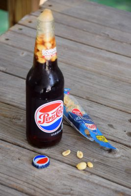 A handful of salted, roasted peanuts poured into a bottle of Pepsi makes for a flavor combination that may not appeal to everyone. Photo: Mark Hibbs