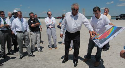 Rep. John Torbett, chair of a House long-range transportation planning committee, and Chris Gibson, a consultant for North Topsail Beach, review a map of inlet shoaling during the committee tour of the area. Photo: Kirk Ross