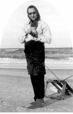 Nellie Myrtle Pridgen is shown doing what she spent much of her 74 years enjoying, scouting for beach glass, bottles, old toys and anything else of interest that washed up. Photo: Outer Banks Beachcomber Museum