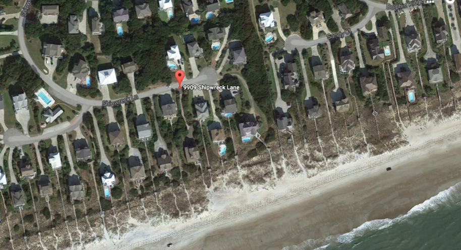 Gregory and Diane Nies of 9909 Shipwreck Lane in Emerald Isle contend that the town's use of a 20-foot-wide driving lane across beach sand in front of their oceanfront home amounts to an unconstitutional taking of their private property. Photo: Google Earth