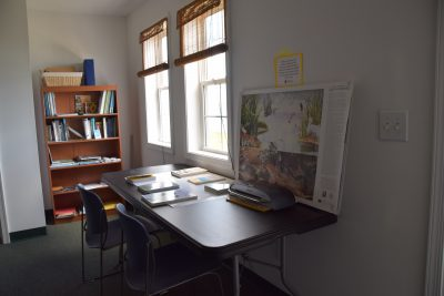 An educational area, filled with books and information designed for children, is possible because of the extra space in the new office. Photo: Ashita Gona.