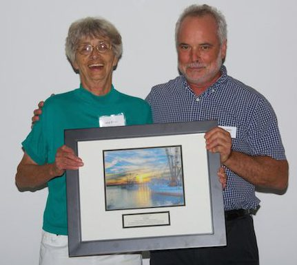Todd Miller awards Lena Ritter a Lifetime Achievement Award in 2013. Photo: N.C. Coastal Federation