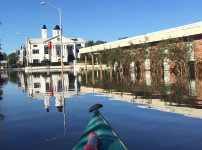 Floodwaters reflect the Bertie County Courthouse in Windsor, and at right is the library, flooded again for the second time in a month. Contributed Photo by Scott Sauer