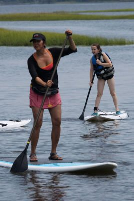 April Clark leads a stand-up paddleboard class. Photo: Jennifer Miller Pearce