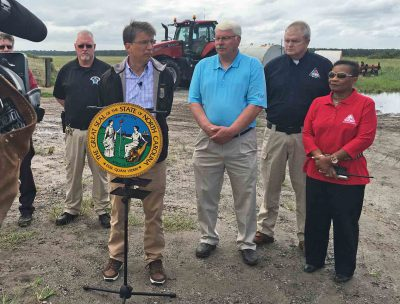 Gov. Pat McCrory and Agriculture Commissioner Steve Troxler speak during a visit to Washington and Tyrrell counties in September. Photo: Governor's office
