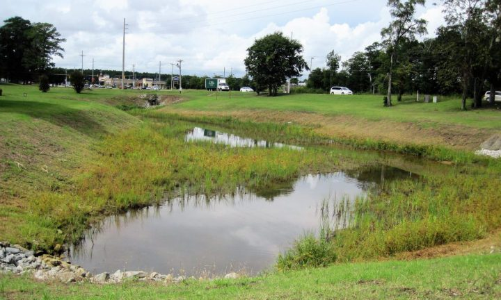 The nearly completed restoration of the church ponds in Cape Carteret is handling runoff as designed. Photo: North Carolina Coastal Federation