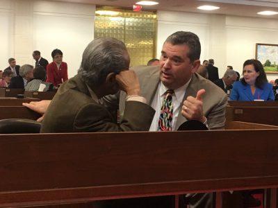Rep. Henry Michaux Jr., D-Durham, left, and Rep. David Lewis, R-Harnett, speak Wednesday during the break between sessions. Photo: Kirk Ross