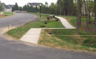 A grassy swale, such as this, allow stormwater to pool and percolate through the ground. Photo: Department of Environmental Quality