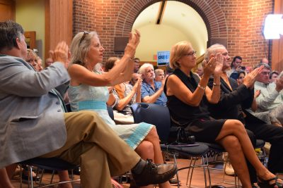 Attendees applaud Gov. Roy Cooper's announcement Thursday at Fort Macon State Park that he would lead the fight against offshore drilling. Photo: Mark Hibbs