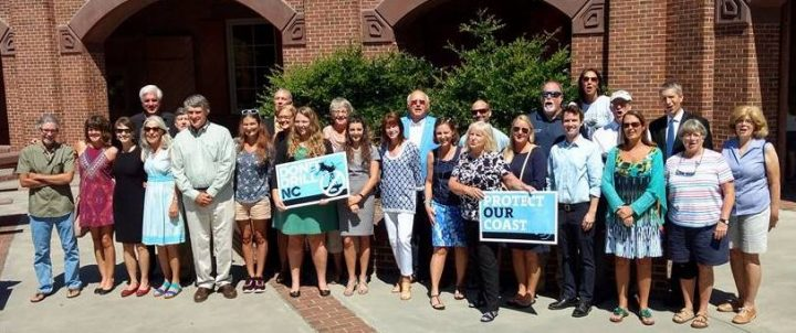 Members of the Save Our Sea group and other environmental advocates pose at Fort Macon State Park where Gov. Roy Cooper recently announced his opposition to offshore drilling and seismic testing. Photo: Contributed