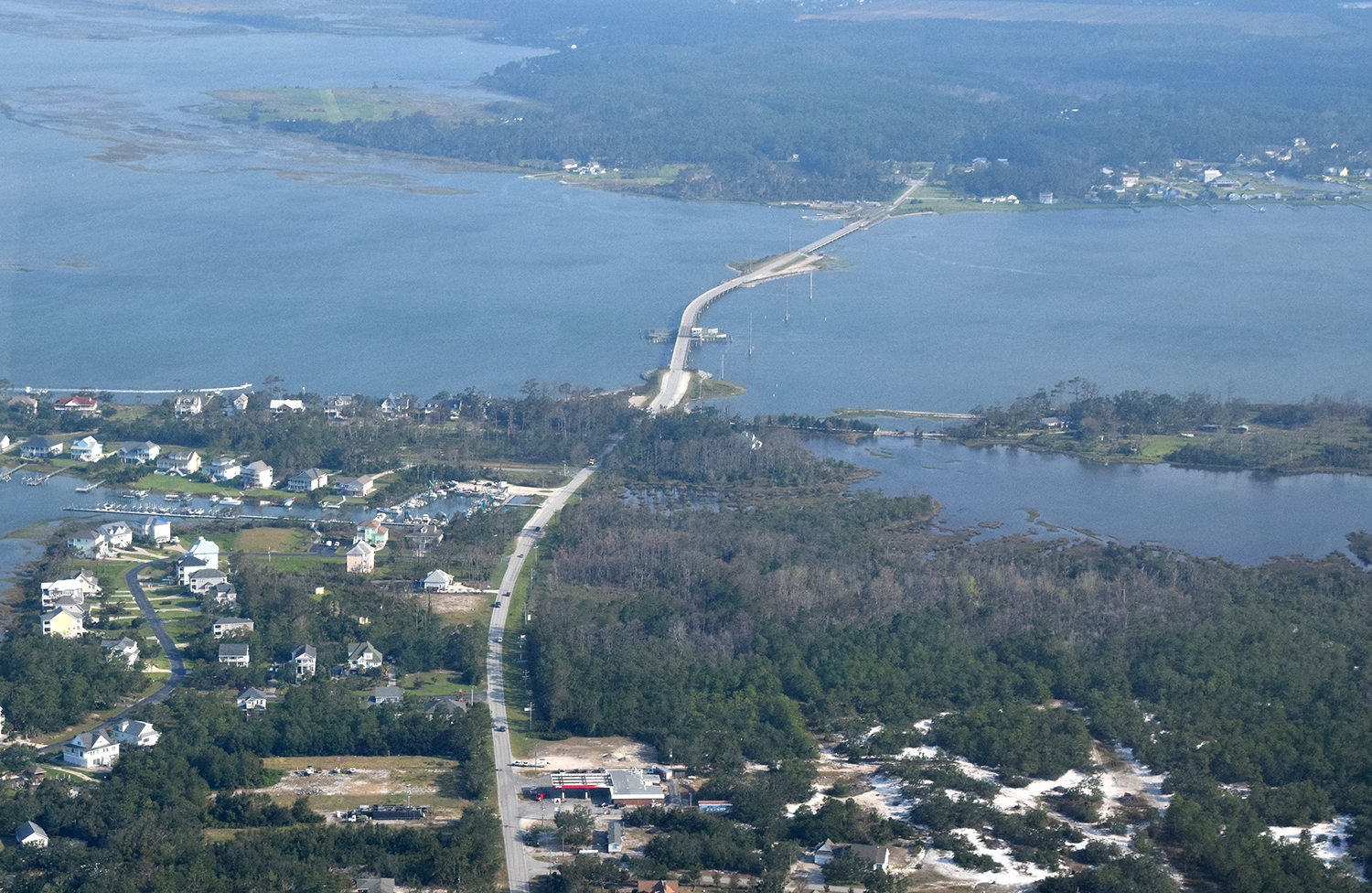 The North Carolina Department of Transportation has awarded contracts to replace the swing-span Earl C. Davis Memorial Bridge and Bridge No. 96, both of which connect the Straits township shown at top to Harkers Island. Photo: Mark Hibbs