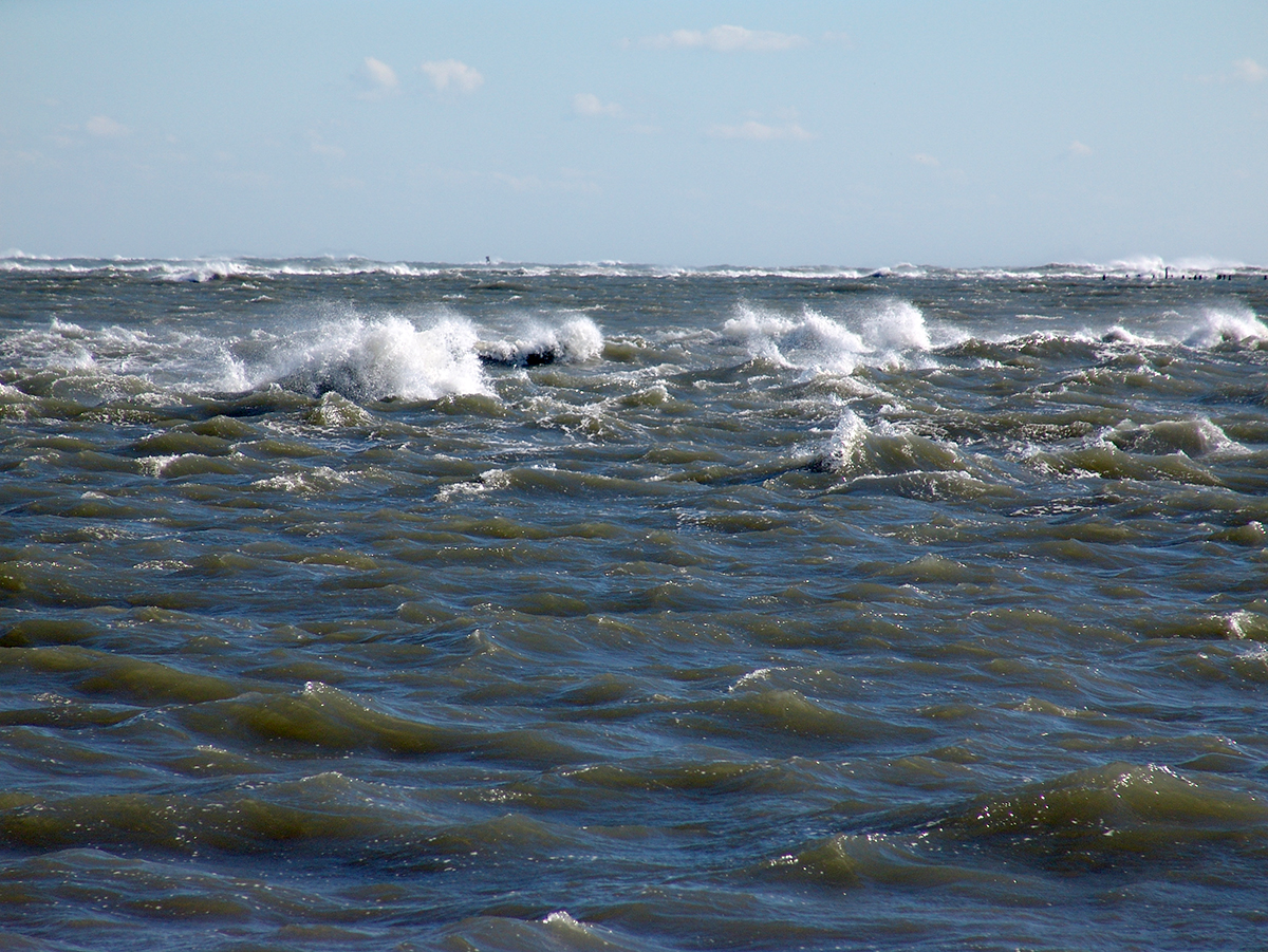Waves crest over the shoals in Hatteras Inlet in this view from the ferry to Ocracoke. Photo: Vicki Harrison