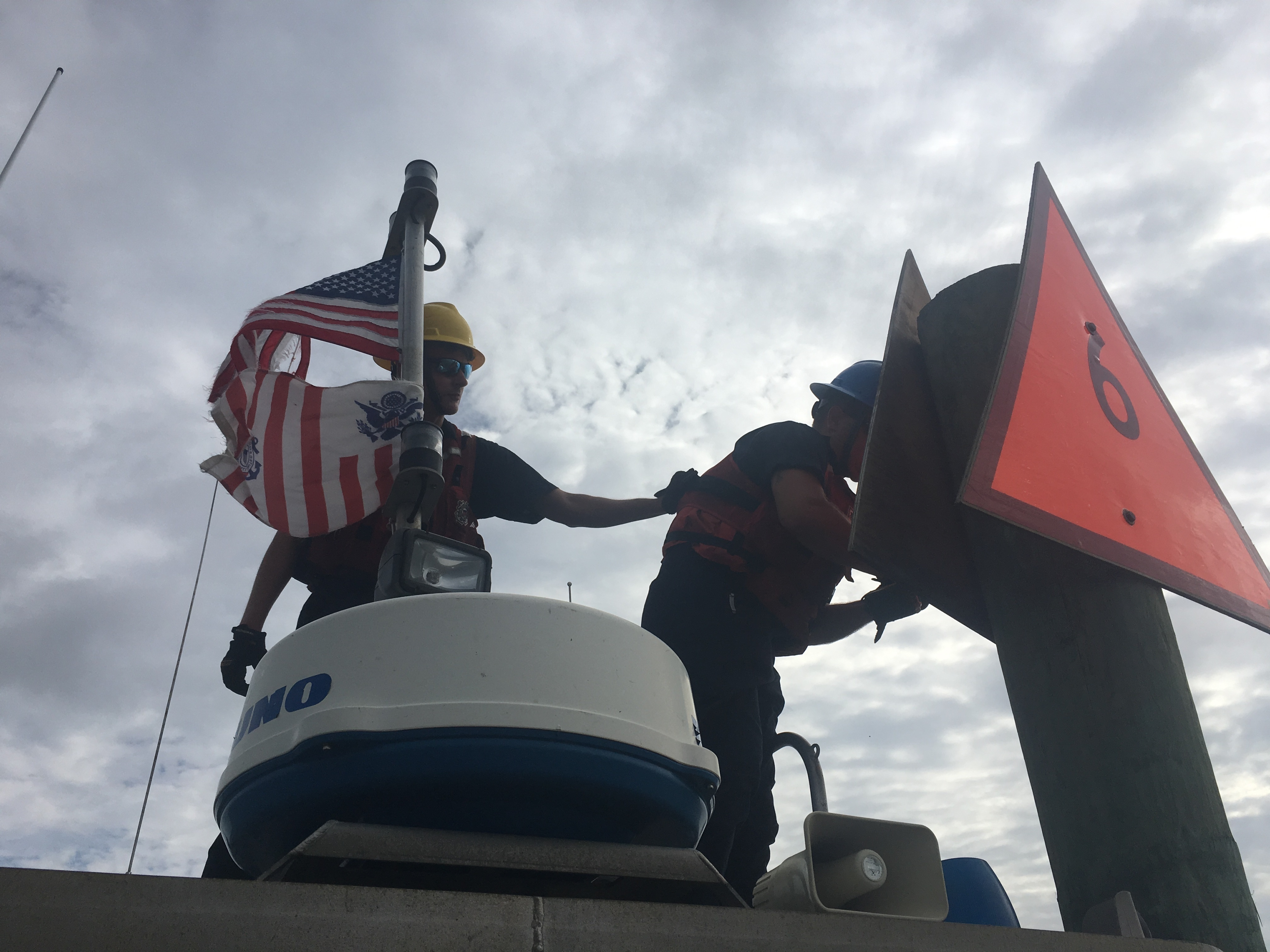 A Coast Guard crew from Aids-to-Navigation Team Fort Macon replaces a dayboard in the Intracoastal Waterway after Hurricane Florence in 2018. The Coast Guard is changing more than two dozen aids to navigation in waters around Shackleford Banks and Harkers Island. Photo: USCG