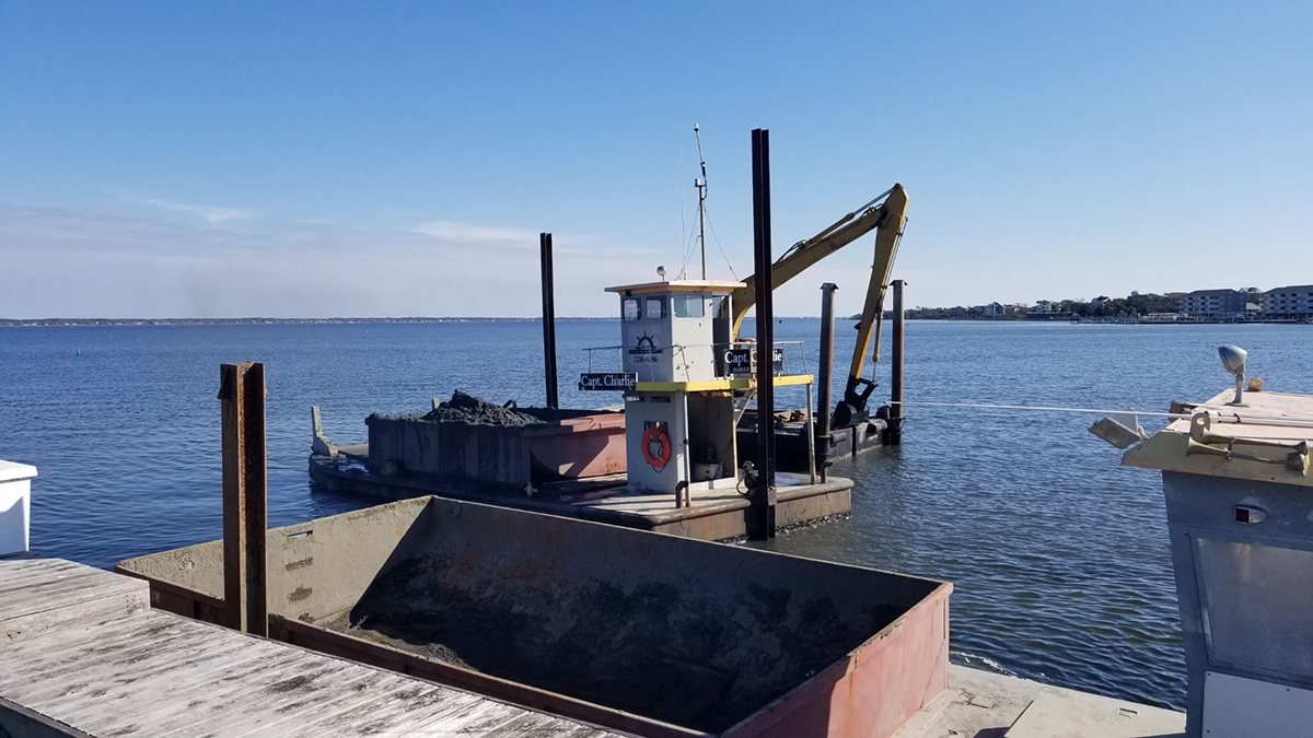 A private dredge operation is shown underway in 2019 at a Carteret County marina. Photo: Carteret County Shore Protection Office