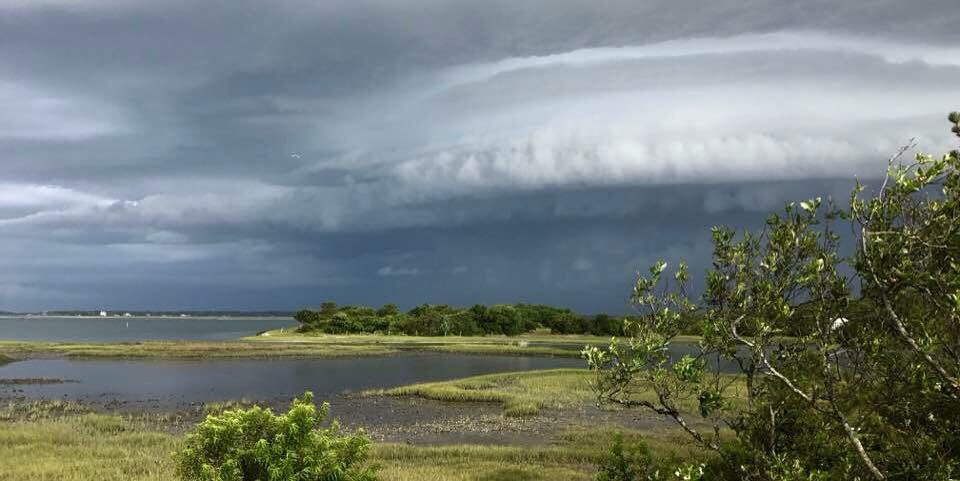 A storm cloud hovers over Harkers Island in this undated National Weather Service photo. Photo: Chuck Laughridge/NWS