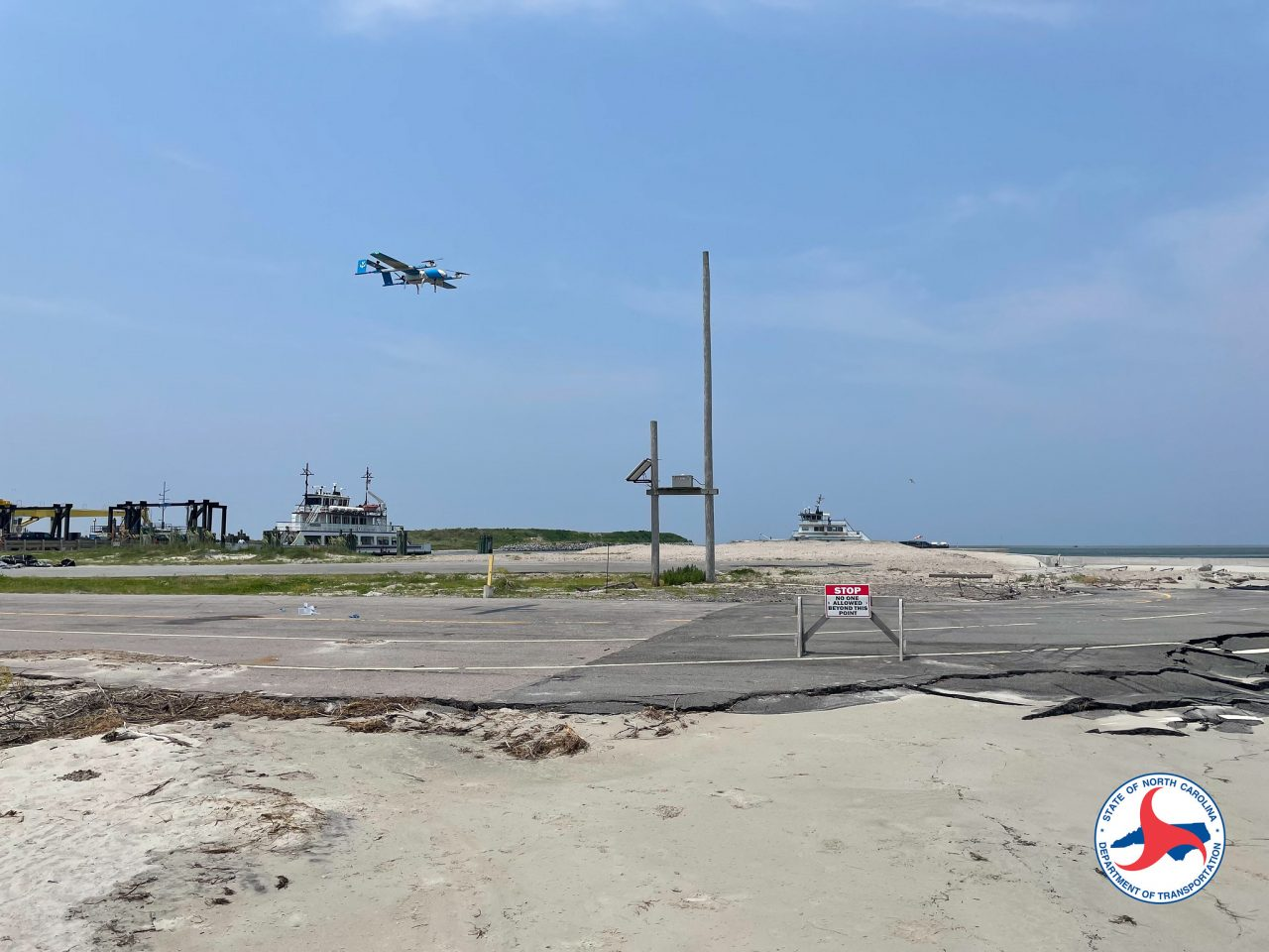 A drone lands in Ocracoke Thursday during a trial delivery. NCDOT