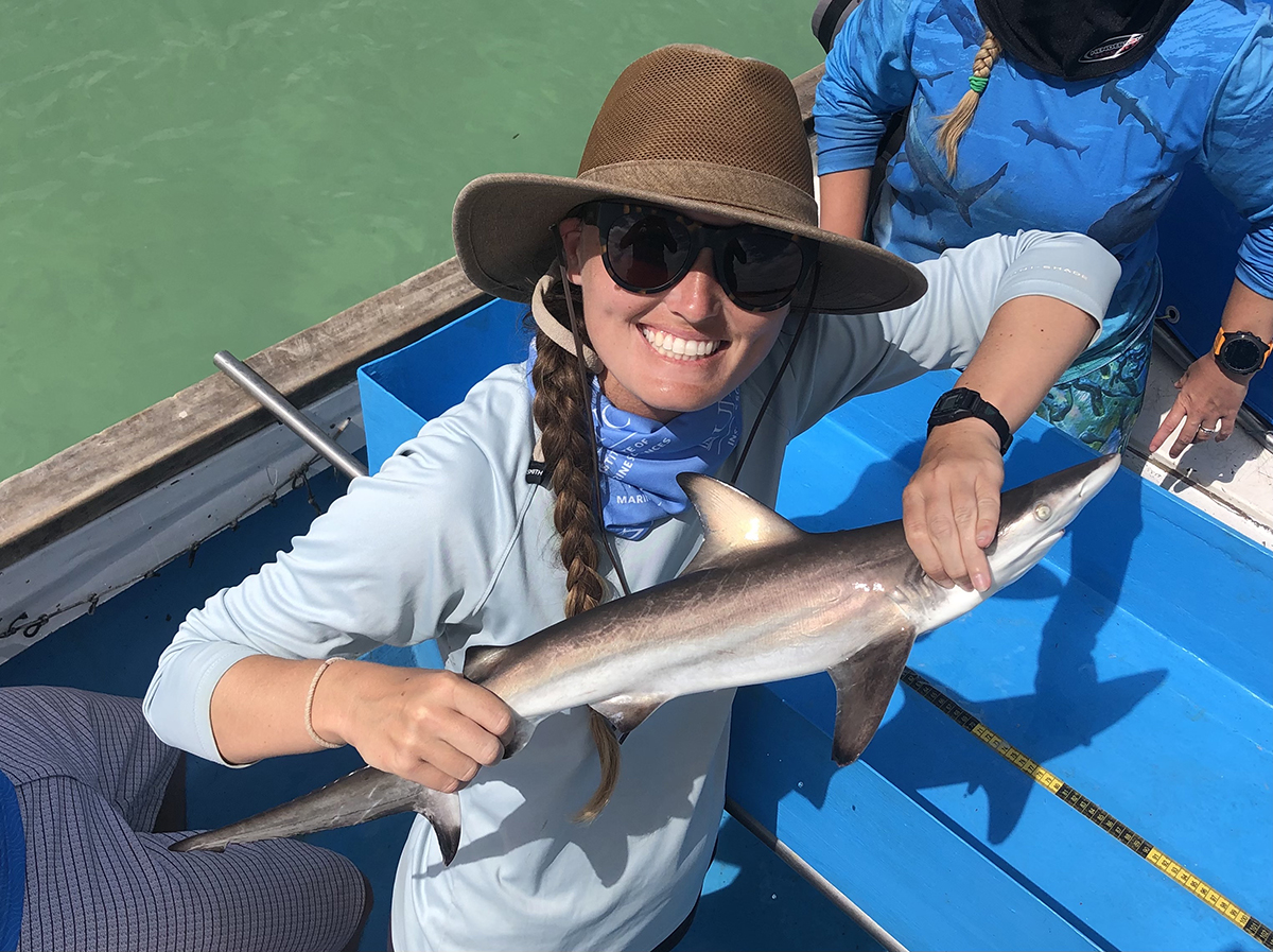 Savannah Ryburn holds a juvenile blacktip shark during her fieldwork in the Galapagos. Photo: Contributed