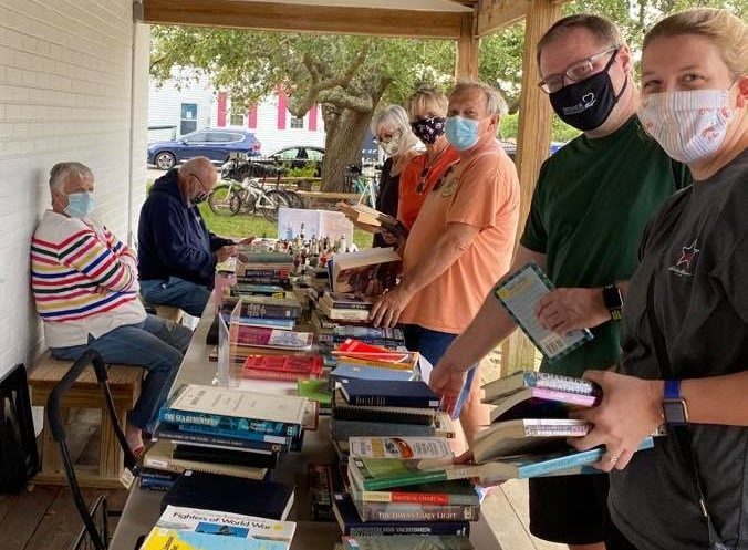 BOOKWORM: Volunteers help at the N.C. Maritime Museum's book sale, which raises funds to purchase maritime-related books for the museum library.  Photo: N.C. Maritime Museums