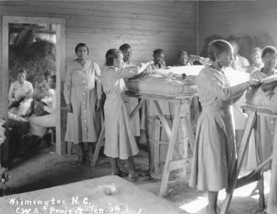 An Federal Emergency Relief Administration (FERA) pine straw mattress factory for unemployed women in Wilmington, N.C., ca. 1934. The FERA was a predecessor of the WPA. Courtesy, State Archives of North Carolina