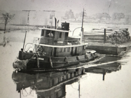 The tug Clay Foreman carrying a barge load of logs to the Foreman-Blades Lumber Mill in Elizabeth City, N.C. Courtesy, Museum of the Albemarle