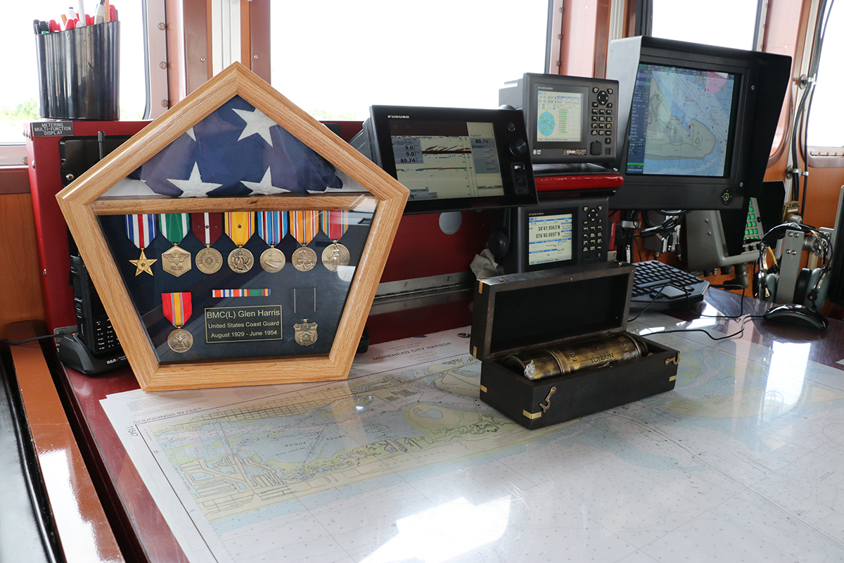Chief Petty Officer Glen Harris' service medals and spyglass are displayed on the bridge of the Coast Guard cutter that bears his name. Photo: Ann Cary Simpson
