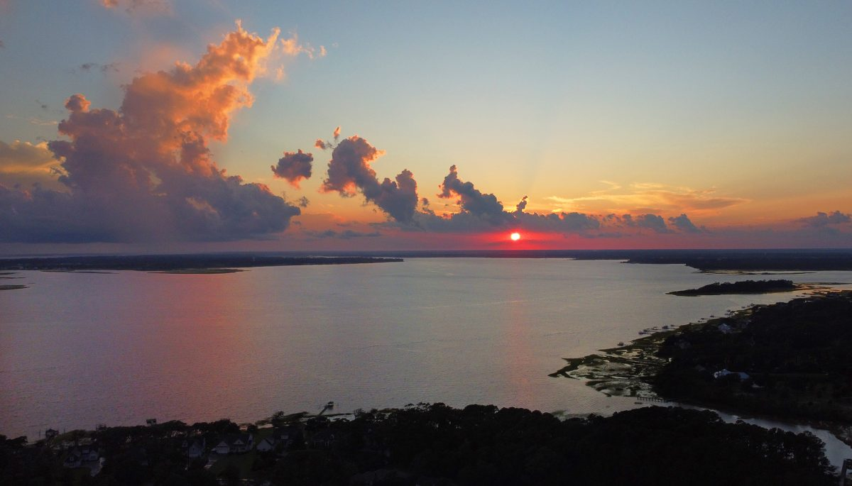 The sun sets over the Newport River in between Beaufort and Morehead City in Carteret County. Photo: Dylan Ray