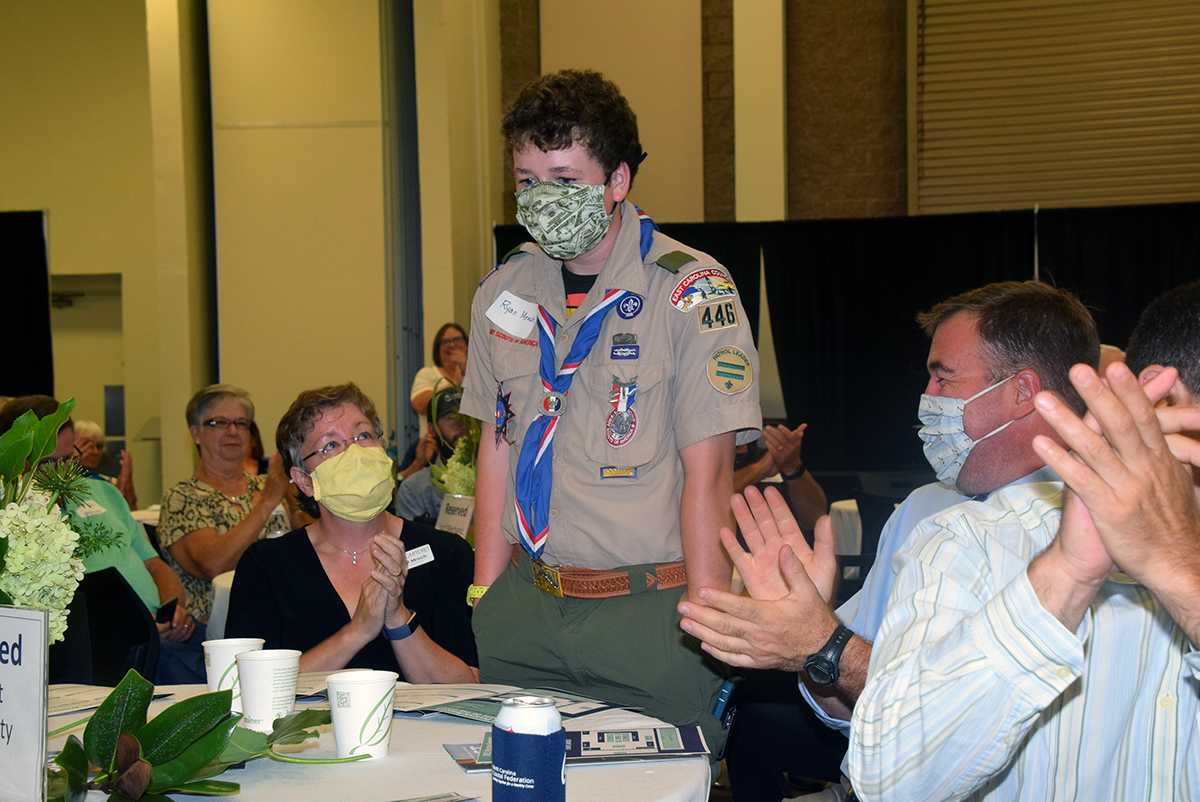 Scout Ryan Mrock of Troop 446 of Cape Carteret reacts in surprise he is announced winner of a special Junior Pelican Award during the North Carolina Coastal Federation's annual recognition of coastal stewardship Saturday at the Crystal Coast Civic Center in Morehead City. Photo: Mark Hibbs