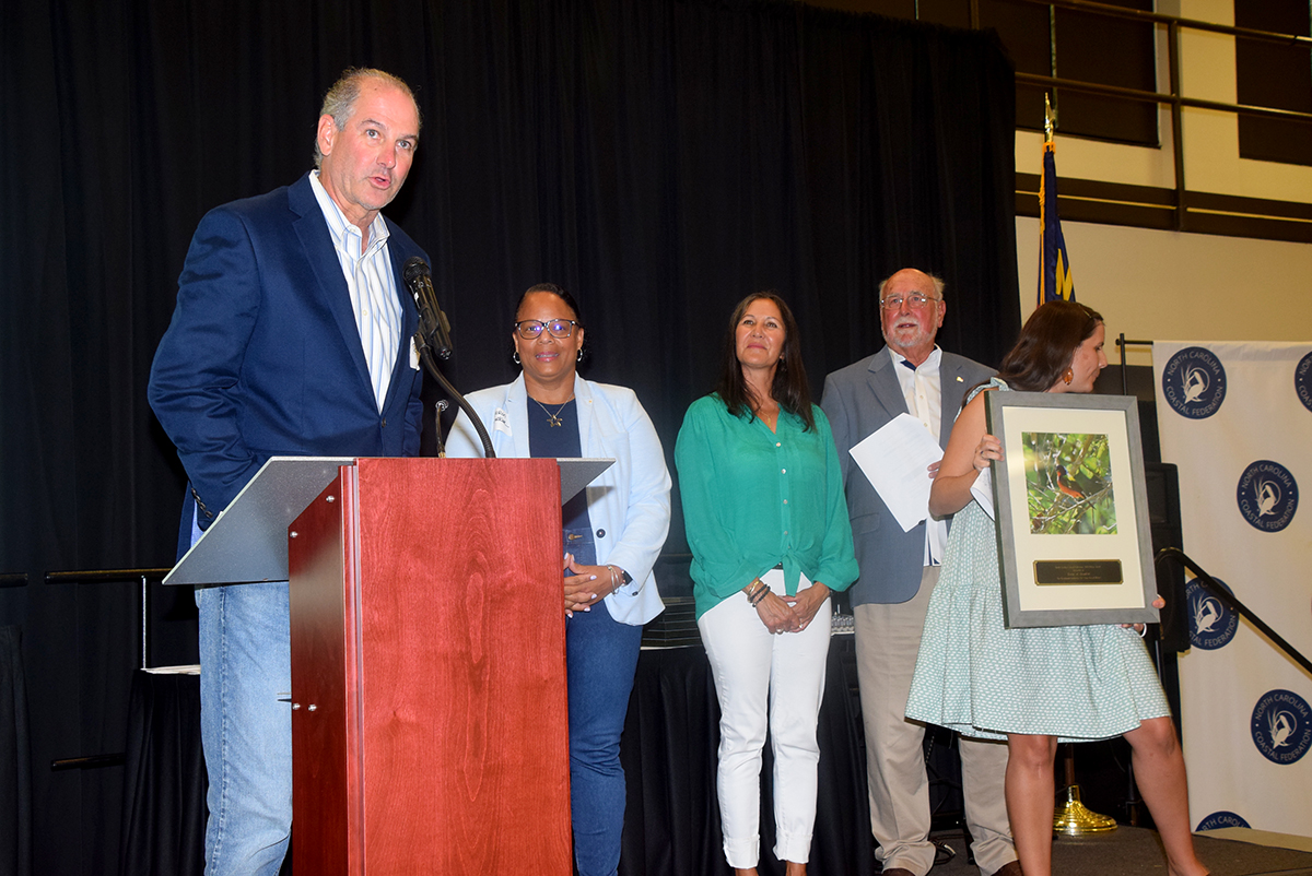 Beaufort Mayor Rett Newton speaks as the town is recognized with a Pelican Award for exceptional leadership for clean coastal waters. Photo: Mark Hibbs