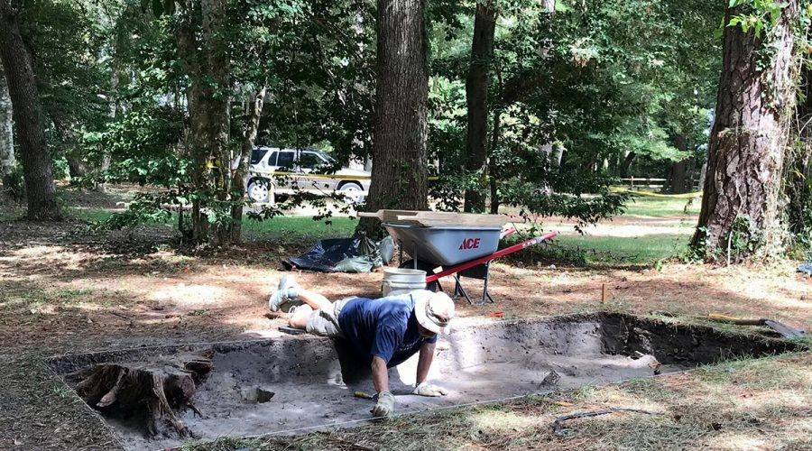 A volunteer works in an excavation pit at Fort Raleigh National Historic Site. Photo: Catherine Kozak
